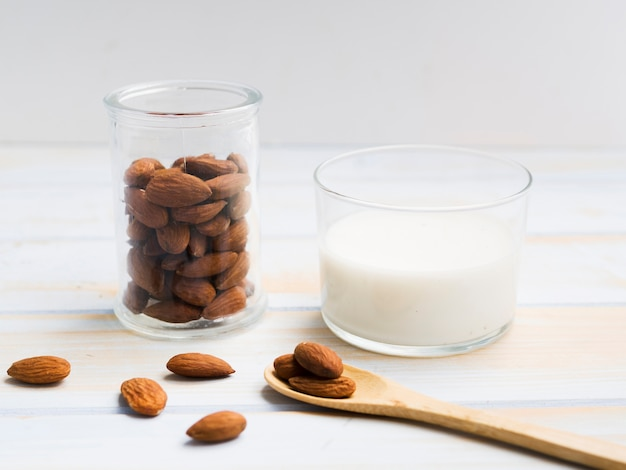 Glass of milk with almonds Free Photo