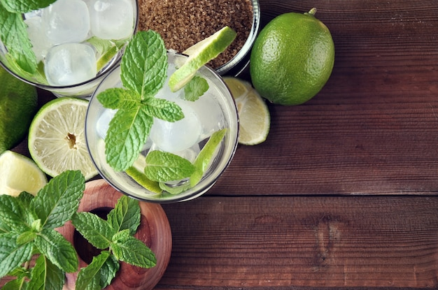 Glass of mojito cocktail with mint, lime and sugar Premium Photo