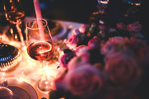 Glass of wine on a decorated table Free Photo