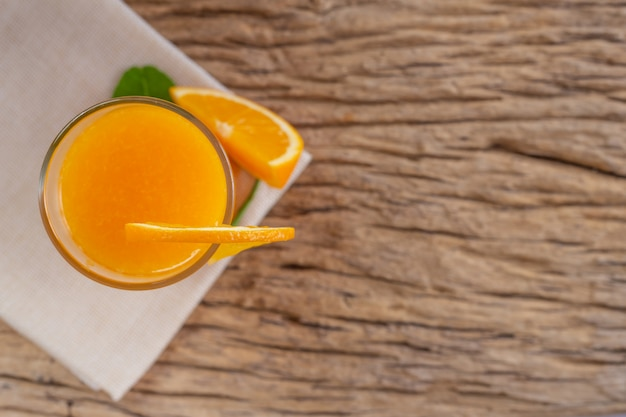 Glass of orange juice placed on wood. Free Photo