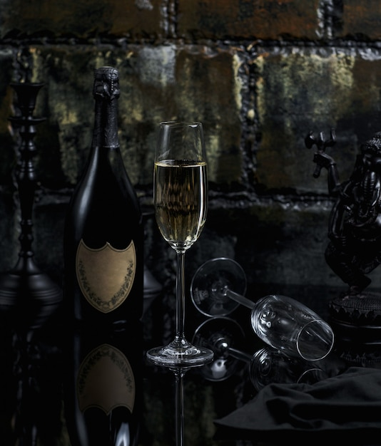 A glass of prosecco with bottle around Free Photo