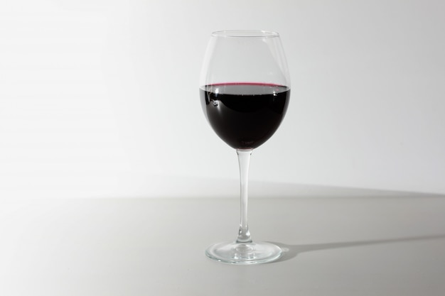 Glass of red wine isolated on white Premium Photo