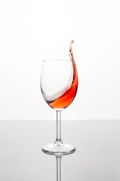 Glass of red wine with wave Premium Photo