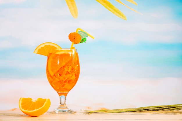 Glass of refreshing juicy drink and sliced orange Free Photo