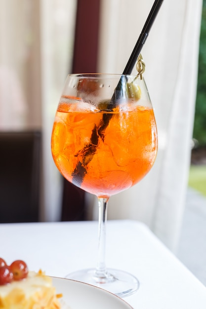 A glass of sangria on a white table. restaurant table setting. summer mood. Premium Photo