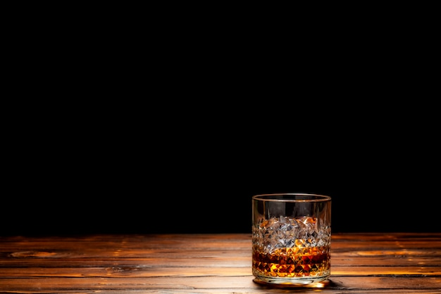 A glass of scotch whiskey or whisky on the rock Premium Photo