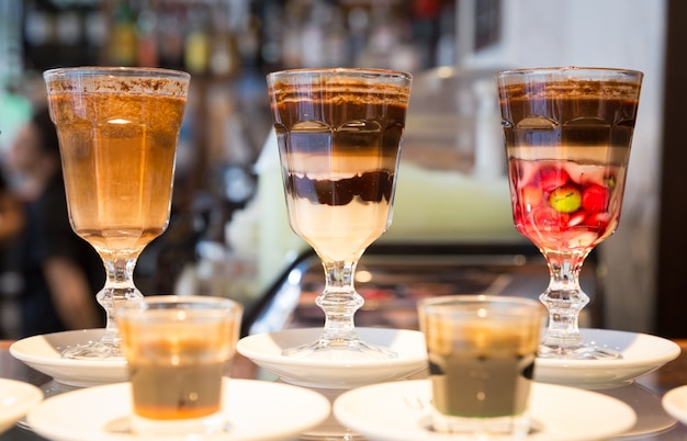 Glass of special sweet coffee desert in cafe Premium Photo