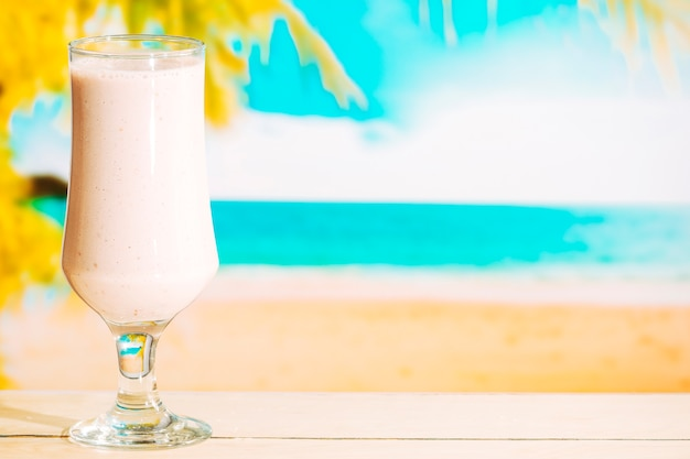 Glass of sweet cold milkshake Free Photo
