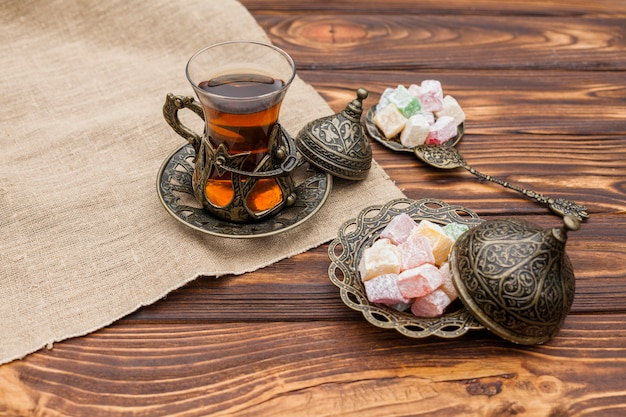 Glass of tea with turkish delight on table Free Photo
