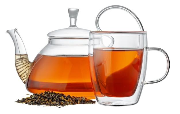 白で隔離のお茶とガラスのティーポットとガラスのカップ Premium写真