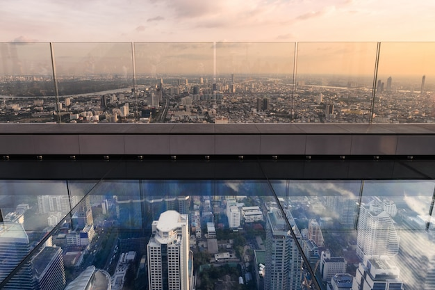 Glass terrace with bangkok city on rooftop Premium Photo