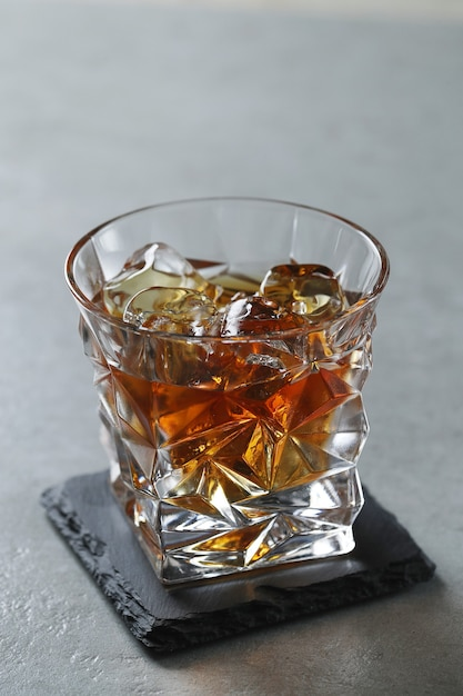 Glass of whiskey or bourbon, only with ice Free Photo