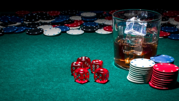 Glass of whiskey on casino table Free Photo