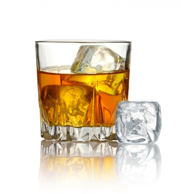 Glass of whiskey and ice isolated on white Premium Photo