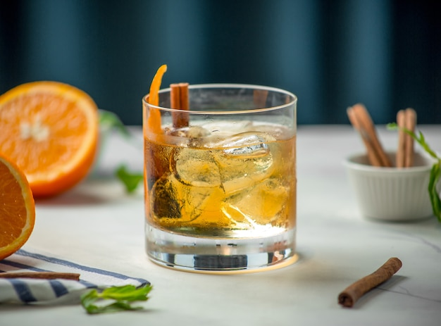Glass of whiskey with cinnamon Free Photo