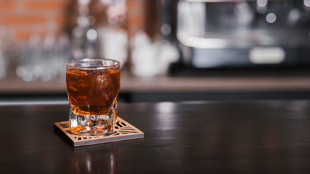 Glass of whiskey with ice cubes Free Photo