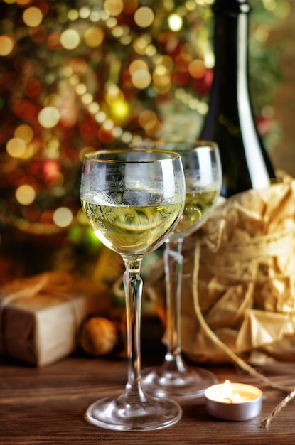 Glass of wine and christmas decoration Premium Photo