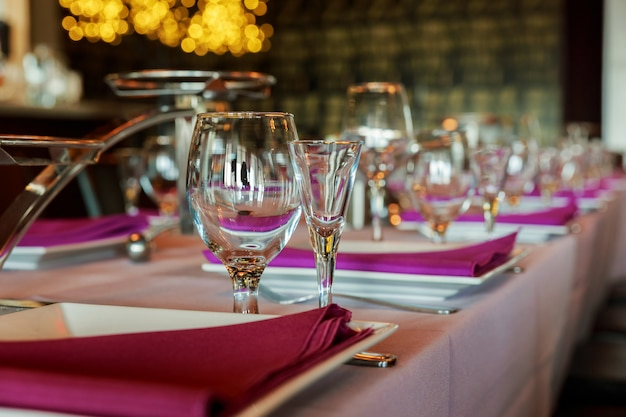 Glass wine glasses on the table served for the reception the restaurant Premium Photo