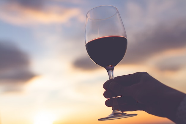 A glass wine at sunset in the evening. Premium Photo