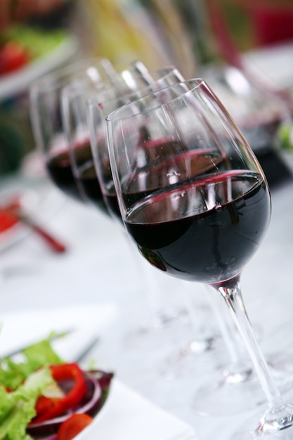 Glass of wine on the table Free Photo