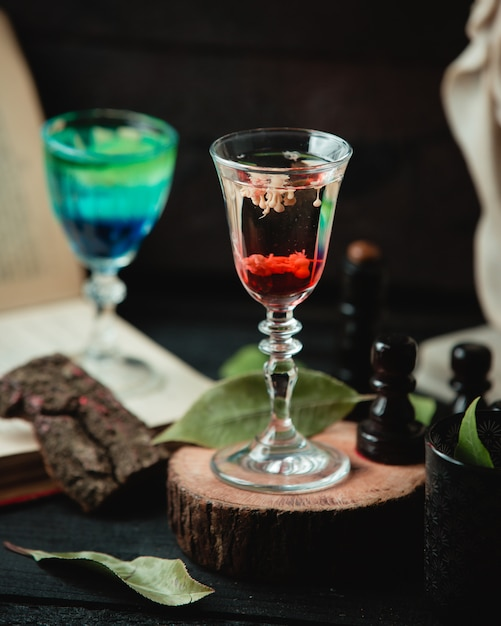 Glass with alcohol beverage on the table Free Photo