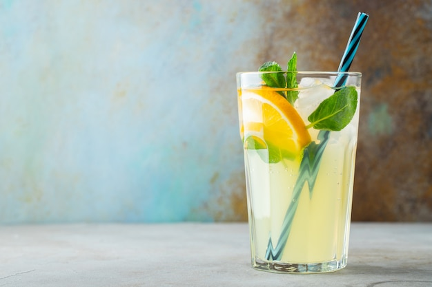 Glass with lemonade or mojito cocktail. Premium Photo