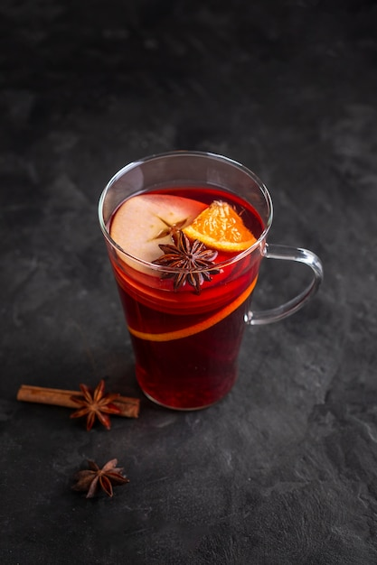 Glass with mulled wine and condiments Free Photo