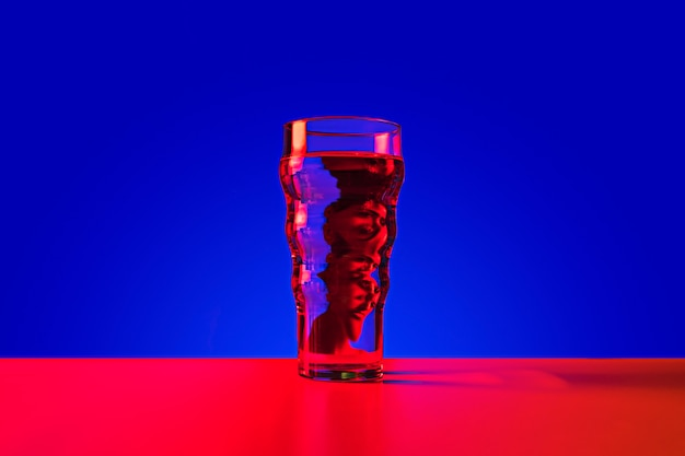Glass with reflection of a man Free Photo