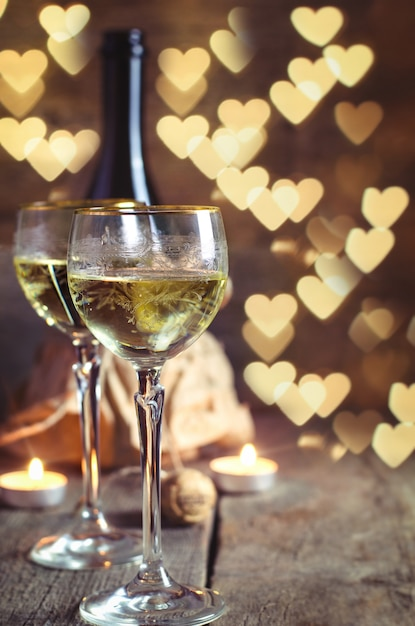 Glass with wine on romantic valentines day Premium Photo