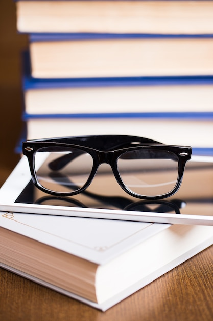 Glasses and a book Free Photo