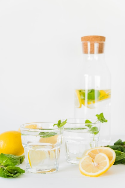 Glasses and bottle with lemon mint drink Free Photo
