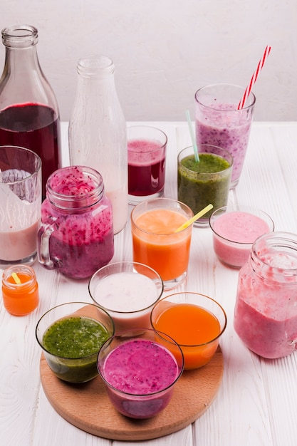 Glasses and bottles with colorful drinks Free Photo