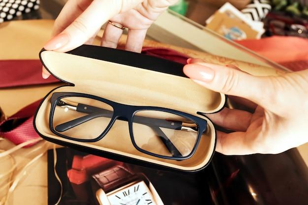 Glasses in case, stylish optics, flat lay, vintage, optics store. Premium Photo