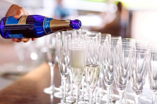 Glasses for a champagne on a table. Premium Photo