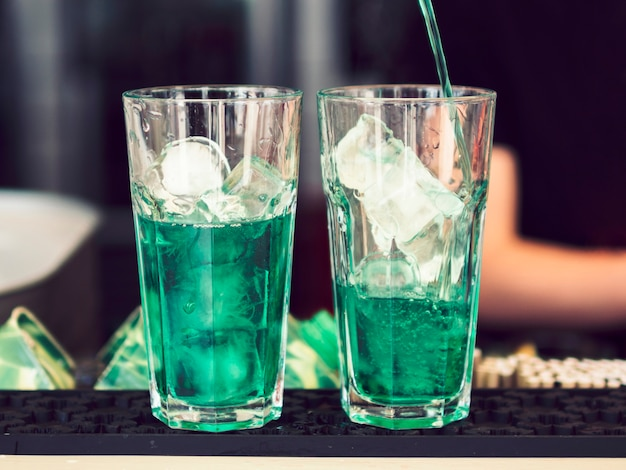 Glasses of colourful green beverage Free Photo