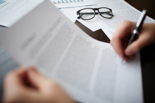Glasses on documents Free Photo