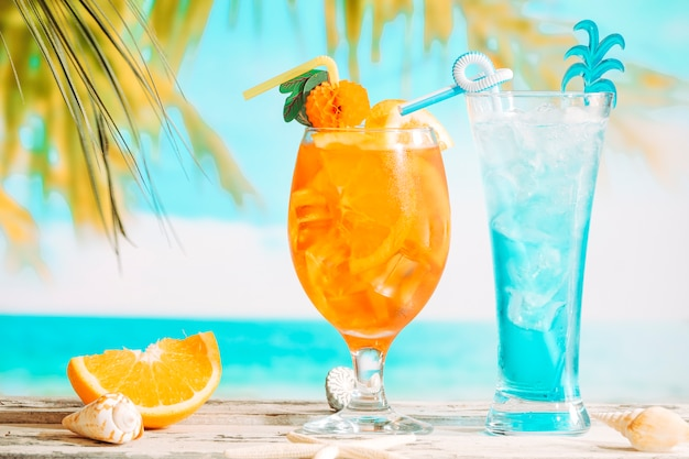 Glasses of fresh drinks decorated with citrus and sliced orange starfish Free Photo