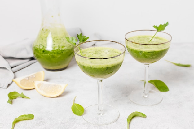 Glasses of healthy smoothies with lemon slices Free Photo