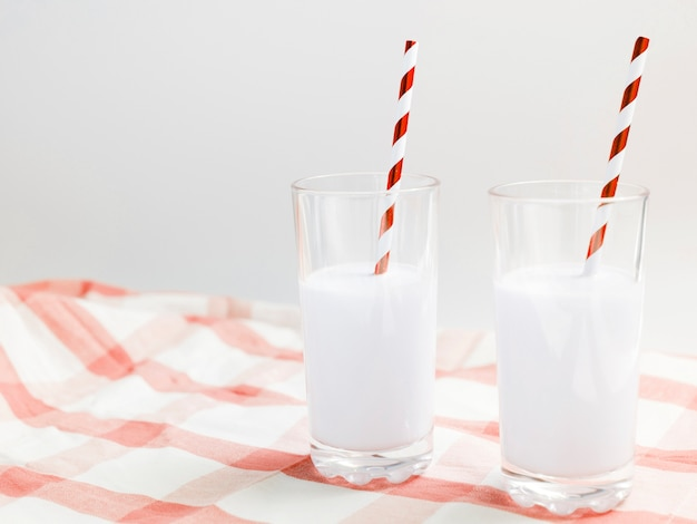 Glasses of milk with straw Free Photo