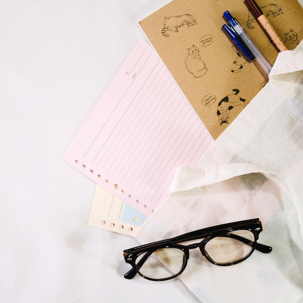 Glasses near notebook pages Free Photo