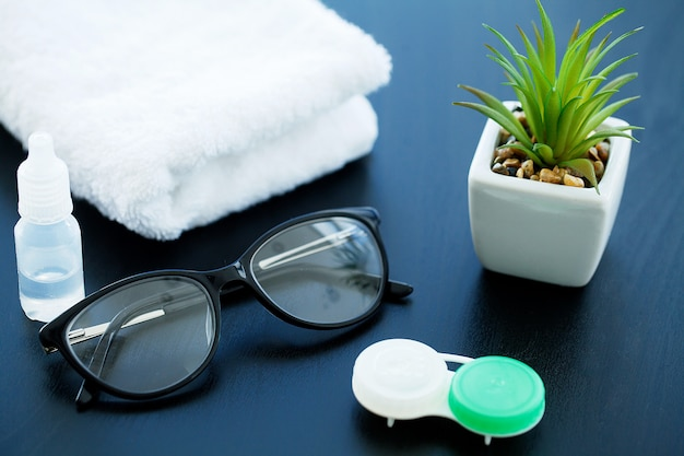 Glasses and objects for cleaning and storing contact lenses, to improve vision Premium Photo
