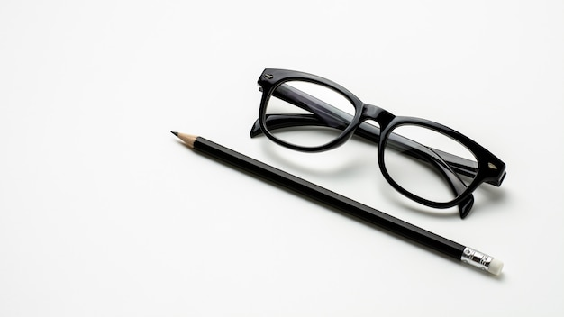 Glasses and a pencil on white background Premium Photo