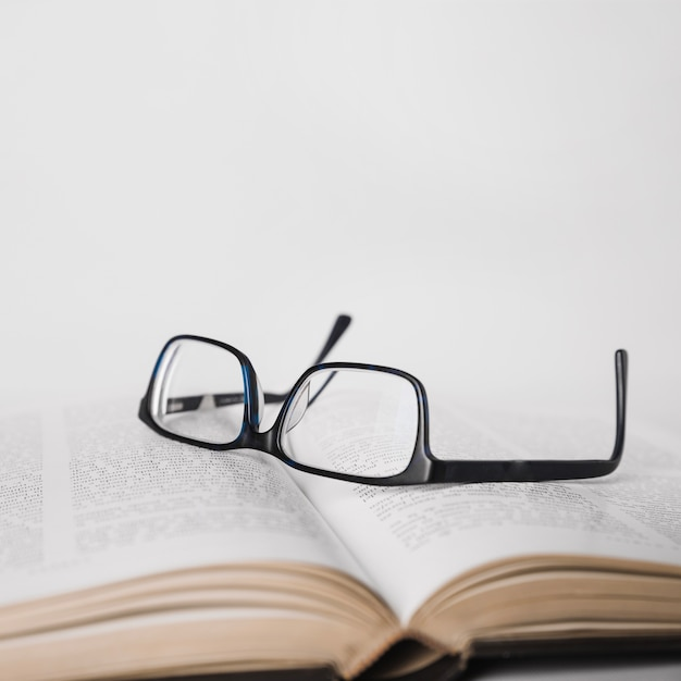 Glasses placed on book Free Photo