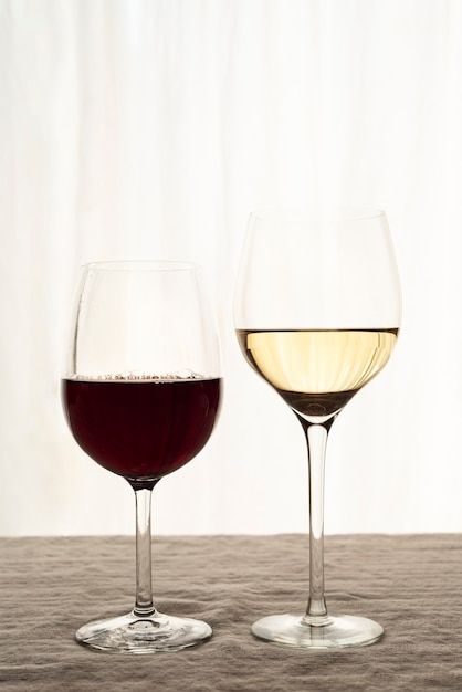 Glasses of red and white wine Free Photo