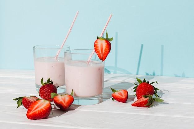 Glasses of strawberry yogurt with berries Free Photo