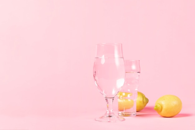 Glasses of water and lemons Free Photo