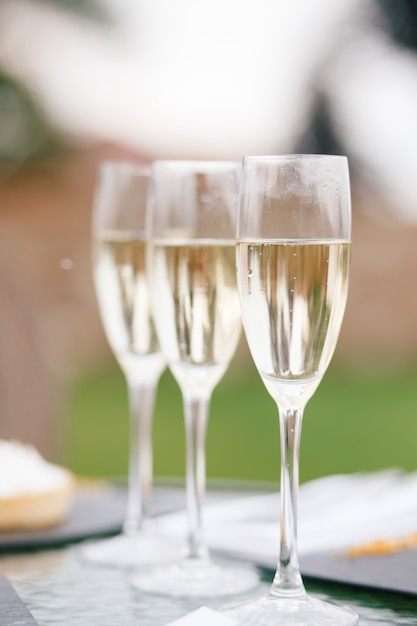 Glasses with champagne stand on the table Free Photo