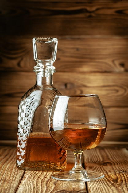 Glasses with cognac, whiskey stand on the bar Premium Photo