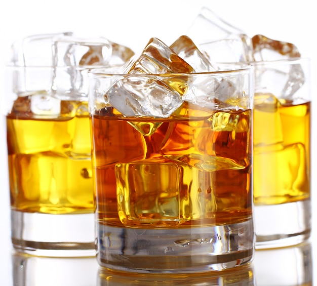 Glasses with cold whiskey Free Photo