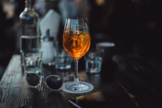 Glasses with wine and cocktail on the table in a cafe Premium Photo